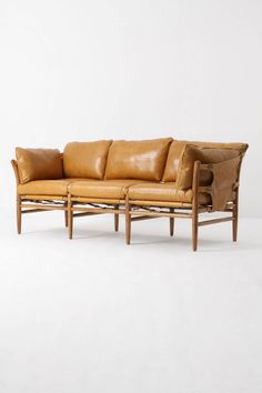 "Patrizia Sofa in dark yellow with buckled sides over a hardwood frame, 6,000.00. (36""H, 86""W, 38""D)"