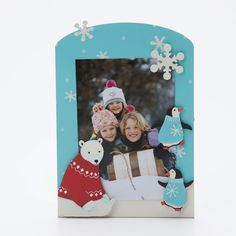 Create custom frames for all occasions.  Winter Scene with Polar Bear and Penguins from Embellish Your Story by Roeda.