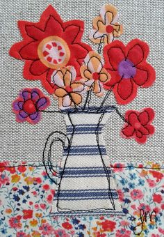 Red flowers in jug - framed freestyle machine embroidery