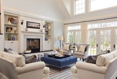 Furniture Layout Ideas : Balance and Symmetry - Kylie M Interiors. Learn how to create a furniture layout using your main pieces like a couch and 2 chairs. Shown in this living room with white, cream and blue accents with striped chairs and a striking fireplace