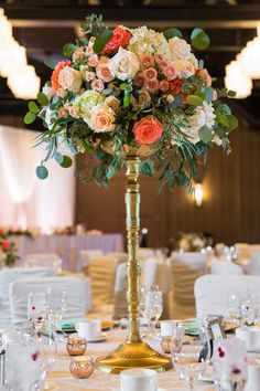 Coral, green and pink tall wedding centrepiece consisting of peonies, roses, eucalyptus and succulents   Hotel Arts Calgary, AB wedding