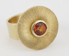 Whirl - hand engraved with orange garnet from Malyasia.
