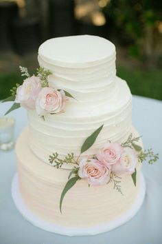 I know this is a wedding cake, but this would make the most beautiful white and pink floral First Communion celebration party cake!