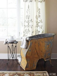 """{A scene from the O'More Designer Show House, featured in @Traditional Home's July/August 2013 issue} Her favorite find for the room was a French campaign sitz bath, a zinc tub painted in a worn yellow and dating from the 1860s. """"It is a rare piece that adds patina, color, history, and character to the space."""""""