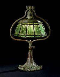 TIFFANY STUDIOS  A LINENFOLD FAVRILE GLASS AND BRONZE TABLE LAMP, CIRCA 1910