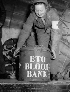 Nurse lifting one of the insulated marmites containing Blood (ETO Blood Bank) onto a continent-bound C-47. These cans were originally designed for containing food and were supplied by the Quartermaster Corps. Source: US Medical Department http://med-dept.com/gallery/equipment-and-supplies/