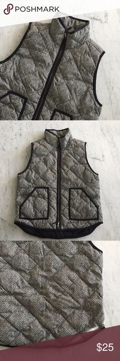 J.Crew Herringbone Vest J.Crew quilted herringbone vest. Works well for fall and is the perfect item if you want to layer. It has a slight discoloration on the back (see third photo). Other than that, it's a great vest. I reccomend styling it with some dark denim and a long sleeve top. J. Crew Jackets & Coats Vests