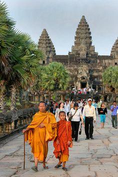 Monks Leaving Angkor Wat, Cambodia by Rob Kroenert