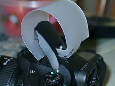 Homemade flash diffuser for pop up flash. Need to find a milk jug.