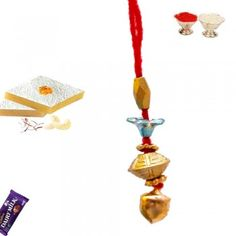 Picture of Golden Bead Bell Lumba Rakhi Buy Rakhi Online, Rakhi To India, Innovation Design, Indian, Drop Earrings, Christmas Ornaments, Holiday Decor, Pictures, Stuff To Buy