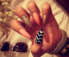 Pink, gold, and chevron stilleto nails.