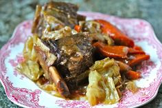 Crockpot Braised Short Ribs : yummy, yummy recipe!  i didn't use the cornstarch but refrigerated the sauce and veg & meat separately.  Then i removed the solidified fat and reheated before serving.