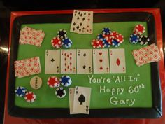 Fun Texas Hold Em poker birthday cake. Playing cards were hand drawn with edible ink on Wilton sugar sheets. Poker chips handmade with fondant.