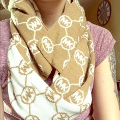 MK Scarf. ❄️Cozy NWOT MK scarf. One side is a cream/white with tan logos and the other side is tan with white/cream logos.                                          ❄️Perfect for chilly days! Michael Kors Accessories Scarves & Wraps