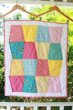 Tumbling Blocks Baby Quilt tutorial by Darci from Stitches and Scissors