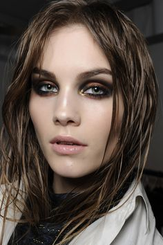 Not for the faint of heart. This evening-perfect style from Roberto Cavalli combines high-pigment metallics with a classic smokey eye. Use black liner to line all the way around the eyes.Trace eyes with copper shadow, then follow with a dab of gold shadow at the inner corners. Blend black shadow into eyelid creases to finish the look. Shop this look: Photo by Greg Kessler
