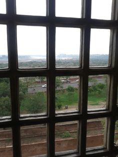 Agra city through blocks, window at Agra Fort, India.