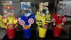 Comic Book Centerpieces I made for my son's Birthday. The are cardboard cut outs my husband did, I modpodge comic pages to them. The long plastic tubes have gumballs in them and lastly decorated with tissue paper and Superhero logo cut-outs Superman Birthday, Avengers Birthday, Superhero Birthday Party, 3rd Birthday Parties, Birthday Ideas, Superhero Party Favors, Birthday Table, Birthday Celebration, Superhero Centerpiece