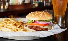 Hurricanes Bar & Grill - Huntington Beach: Burgers, Beers, and Comfort Food with Attitude at Hurricanes Bar & Grill (Up to 56% Off). Four Options Available.