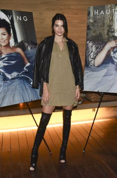 At a party celebrating her mom Kris Jenner's Haute Living cover, Jenner wore a beige shirt dress, leather jacket worn on the shoulders, and thigh-high boots—with a smart little open-toe cut. See? Summery.   - MarieClaire.com