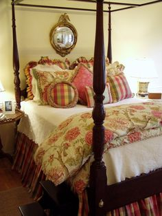Beautiful bedroom! Pretty variety of pillow sizes and styles.  Gorgeous antique bed with lots of fun colors for the bedding. The bedroom has a country and antique look to it! Stunning~
