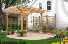 Cedar arbor and trellis, cobble pavers and stone edging.- liking trellis- maybe on hill as fence too?  or to hide fence on east side..