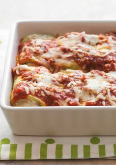 Eggplant Rollatini — Fresh eggplant rolled with cheesy filling and topped with savory sauce makes for an Italian family-pleaser. Hearty, robust comfort food at its flavorful best.