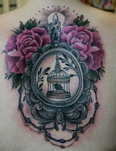 Colored birdcage and flowers tattoo