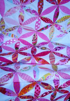 If I had the skillz, this would be the type of quilt I'd make Clara with all of the weekly photo fabrics we've amassed.