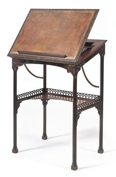 A George III mahogany metamorphic reading table in the manner of Mayhew and Ince circa 1760 Sotheby's