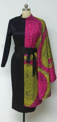 Asymetrical African Print Black Contrast Fabric Fitted Dress with Attached Cape long Sleeves and rolled collar. DETAILS: African Print and Black Stretch Fabric Care Instructions: Dry Clean Only. Press Visit my shop: African American Fashion, African Inspired Fashion, African Print Fashion, Africa Fashion, Ethnic Fashion, Look Fashion, African Style, Womens Fashion, Fashion Outfits