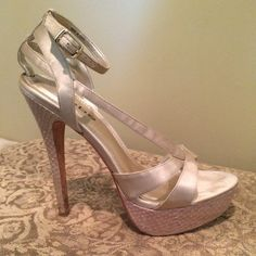 Bebe white champagne gold pumps Barely worn Bebe champagne pumps with snakeskin heel and platform. Great condition , no scuffs or damage. Very sexy and classy!  bebe Shoes Heels