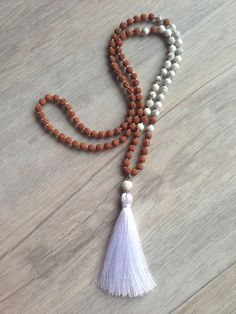 108 Bead Mala Necklace made from 6mm white howlite, rudraksha beads. Featuring silver embellishments and a white silk tassel.  ~ White Howlite ~ is