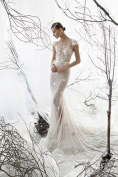 Ethereal Illusion Fit to Flare Wedding Dress | http://heyweddinglady.com/mira-zwillinger-wedding-dress-collection-spring-2017/