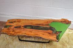 Live edge Yew wood slab coffee table with resin inlay. Brunswickvintage.com