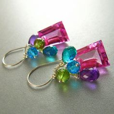 Pink topaz,Amythyst and quartz silver dangle earrings. 130 dollars,hopefully I can convince my boyfriend to buy these for my birthday!