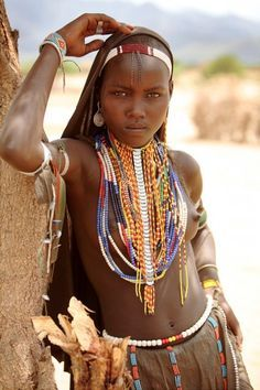 African woman in layers upon layers on Beads - this gives me a great way to wear several necklaces at once