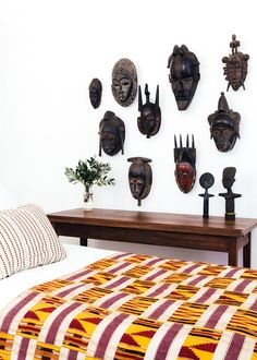 Collection of African masks on a bedroom wall. Made by Master Carver Nana…
