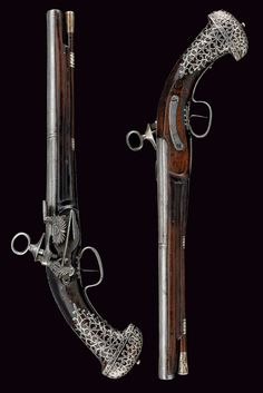 A pair of silver inlaid miquelet pistols originating from Catalonia, late 17th century.