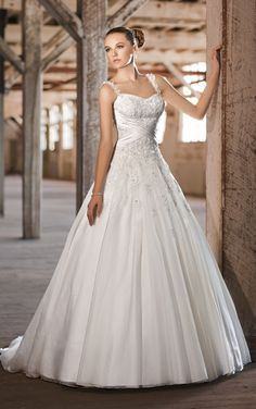 Essence of Australia style D1249 - Fit for a princess, this Soft Organza over Dolce Satin wedding ball gown features delicate embroidery with jewel accents on a sweetheart bodice. Figure flattering crisscross satin ruching at the waist add interest.