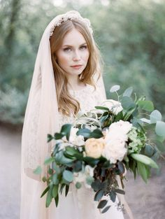 Marie crown with plain long veil. I really like this look.