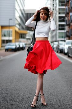 Blogger, Kelly Jaspers of We Heart Fashion, is keepin' it classy in our Dita crop top paired with a fun midi skirt!