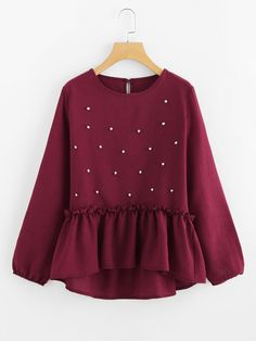 Long Sleeve Blouses. Top Decorated with Pearls, Ruffle, Asymmetrical. Designed with Round Neck. Regular fit. Perfect choice for Casual wear. Plain design. Trend of Spring-2018, Fall-2018. Designed in Burgundy. Fabric has no stretch.
