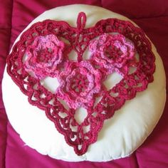 An Irish Crochet Lace Heart done in Yarn for Larger Home Decor:  Cherry Pink 3D Roses inside a Burgundy Irish Picot Lace Heart with a loop for hanging!      Hand-Crocheted in 100% Washable Cotton Yarn