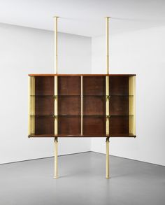 Suspended cabinet, designed for Ferembal House, Nancy, France. Manufactured by Les Ateliers Jean Prouvé, France. 1948