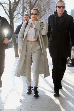 Bella Hadid flashes her abs after arriving in Milan | Daily Mail Online