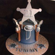 Cowboy gun's in Holster cake.