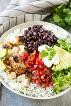 These burrito bowls are loaded with marinated grilled chicken, cilantro lime rice, black beans and a variety of fun toppings.