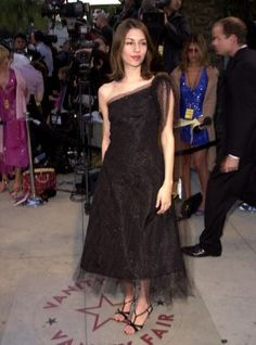 Sofia Coppola, 2001, in a tea-length dress (that kind of checks one off my wish list).