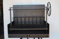 "NorCal Ovenworks Inc. Argentine Exhibition Grill of 3/8"" steel at Extra Place Restaurant, in the East Village."